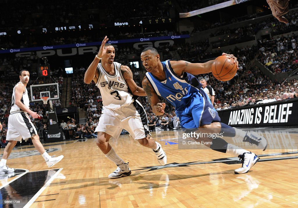 Shawne Williams #4 of the Dallas Mavericks drives against George Hill #3 of the San Antonio Spurs in Game Four of the Western Conference Quarterfinals during the 2010 NBA Playoffs at AT&T Center on April 25, 2010 in San Antonio, Texas.