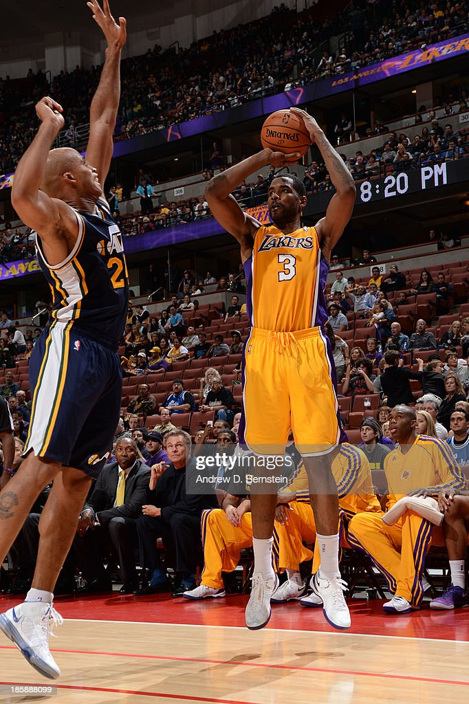 <a gi-track='captionPersonalityLinkClicked' href=/galleries/search?phrase=Shawne+Williams&family=editorial&specificpeople=728608 ng-click='$event.stopPropagation()'>Shawne Williams</a> #3 of the Los Angeles Lakers attempts a shot against <a gi-track='captionPersonalityLinkClicked' href=/galleries/search?phrase=Richard+Jefferson&family=editorial&specificpeople=201688 ng-click='$event.stopPropagation()'>Richard Jefferson</a> #24 of the Utah Jazz during a preseason game at the Honda Center in Anaheim, California on October 25, 2013.