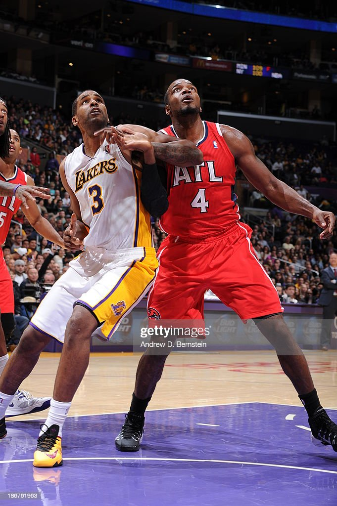 Shawne Williams #3 of the Los Angeles Lakers attempts to box out Paul Millsap #4 of the Atlanta Hawks on November 3, 2013 at STAPLES Center in Los Angeles, California.