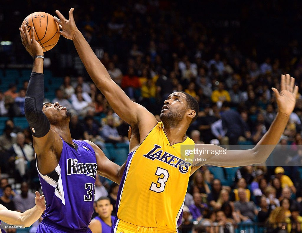 Shawne Williams #3 of the Los Angeles Lakers knocks the ball away from Jason Thompson #34 of the Sacramento Kings during their preseason game at the MGM Grand Garden Arena on October 10, 2013 in Las Vegas, Nevada. Sacramento won 104-86.