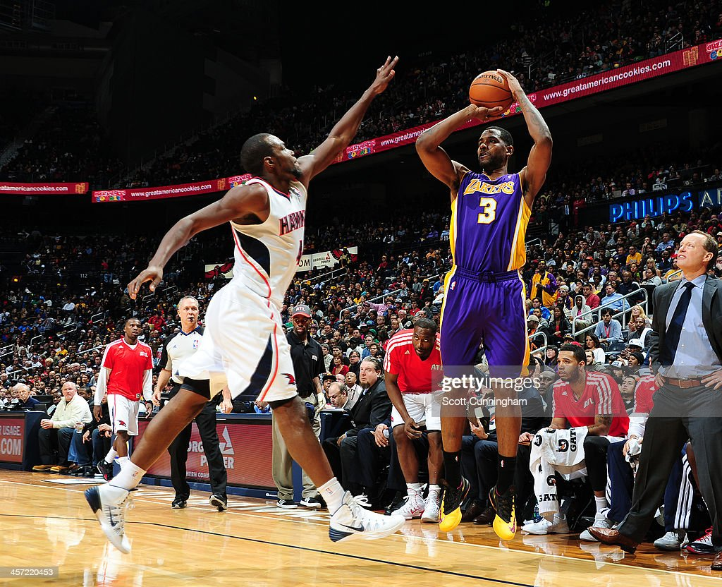 <a gi-track='captionPersonalityLinkClicked' href=/galleries/search?phrase=Shawne+Williams&family=editorial&specificpeople=728608 ng-click='$event.stopPropagation()'>Shawne Williams</a> #3 of the Los Angeles Lakers shoots the ball against the Atlanta Hawks on December 16, 2013 at Philips Arena in Atlanta, Georgia.