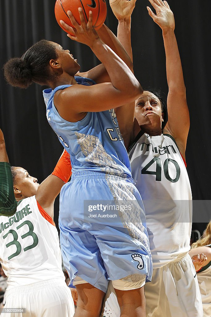 Shawnice Wilson #40 of the Miami Hurricanes attempts to block the shot by Xylina McDaniel #34 of the North Carolina Tar Heels on January 27, 2013 at the BankUnited Center in Coral Gables, Florida. The Tar heels defeated the hurricanes 64-62.