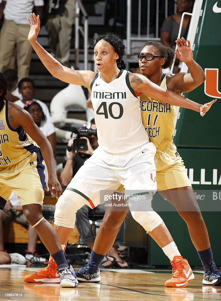 Shawnice Wilson #40 of the Miami Hurricanes gets into position for a pass while being defended by Nariah Taylor #11 of the Georgia Tech Yellow Jackets on January 17, 2013 at the BankUnited Center in Coral Gables, Florida. Miami defeated Georgia Tech 71-65.