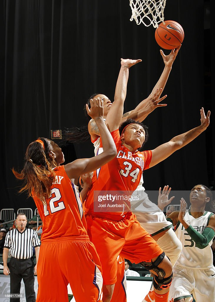 Shawnice Wilson #40 of the Miami Hurricanes goes to the basket over Natiece Ford #34 of the Clemson Lady Tigers on January 3, 2013 at the BankUnited Center in Coral Gables, Florida.