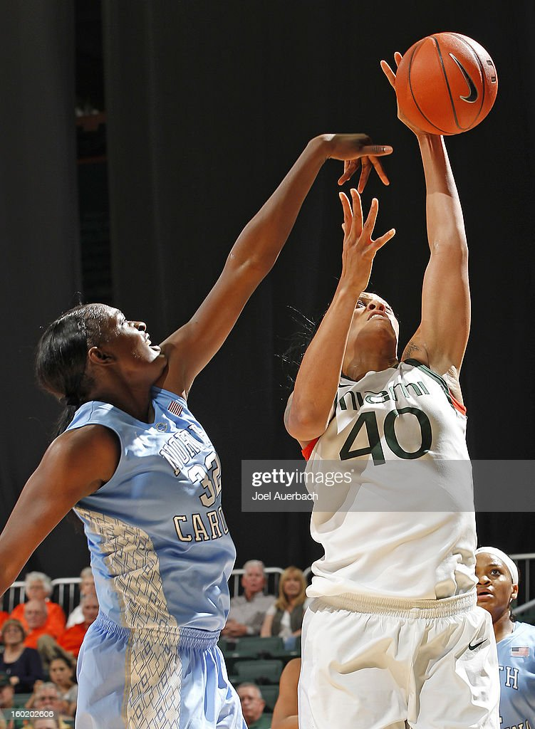 Shawnice Wilson #40 of the Miami Hurricanes is fouled by Waltiea Rolle #32 of the North Carolina Tar Heels as she shoots the ball on January 27, 2013 at the BankUnited Center in Coral Gables, Florida.