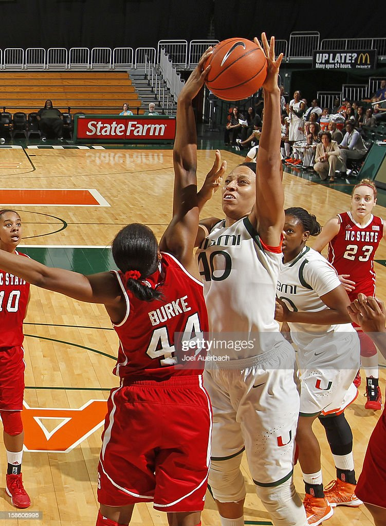 Shawnice Wilson #40 of the Miami Hurricanes shoots the ball over Kody Burke #44 of the North Carolina State Wolfpack on December 20, 2012 at the BankUnited Center in Coral Gables, Florida. The Hurricanes defeated the Wolfpack 79-53.