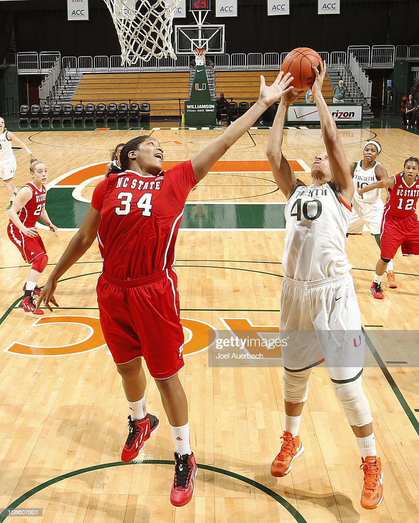 Shawnice Wilson #40 of the Miami Hurricanes takes control of the offensive rebound from Markeisha Gatling #34 of the North Carolina State Wolfpack on December 20, 2012 at the BankUnited Center in Coral Gables, Florida. The Hurricanes defeated the Wolfpack 79-53.