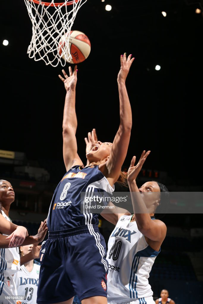 Shawnice Wilson #40 of the Minnesota Lynx goes up for a rebound against Mistie Bass #8 of the Connecticut Sun during the WNBA pre-season game on May 21, 2013 at Target Center in Minneapolis, Minnesota.