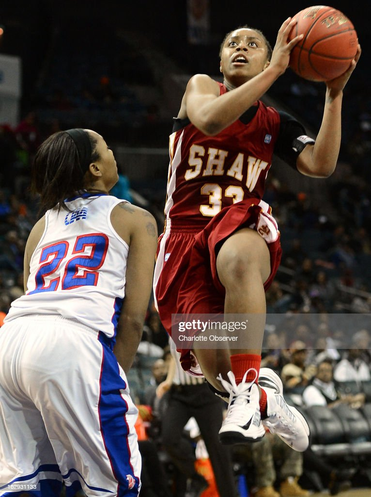 Shaw's Crystal Wilson drives to the basket as Elizabeth City State's Shawnte Taylor (22) tries to establish defensive position during the CIAA tournament semifinals on Friday, March 1, 2013, at Time Warner Cable Arena in Charlotte, North Carolina. Shaw advanced, 76-61.