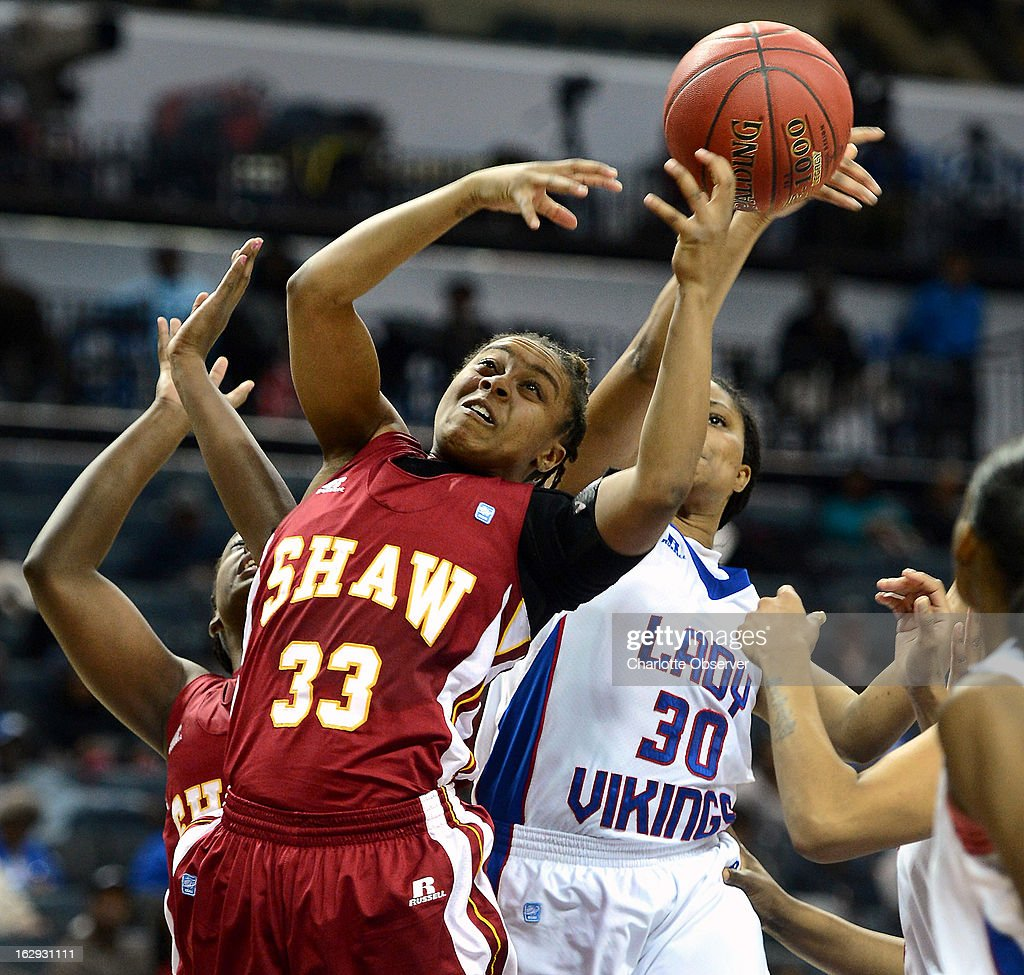 Shaw's Crystal Wilson (33) fights to gain control of a rebound with Elizabeth City State's Jasmine Whitehurst (30) during the CIAA tournament semifinals on Friday, March 1, 2013, at Time Warner Cable Arena in Charlotte, North Carolina. Shaw advanced, 76-61.