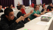 Shawsheen Valley Tech students wave red flags to signal warning signs of fraud during an exercise on Wednesday afternoon in a financial literacy...