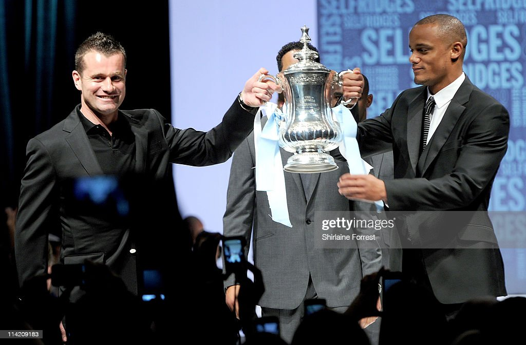 Shay Given and Vincent Kompany lift the FA Cup while wearing Selfridges collection at annual fundraiser organised by Shay Given and his wife Jane in...