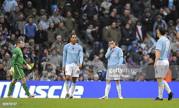 Shay Given Joleon Lescott Wayne Bridge and Gareth Barry of Manchester City look dejected after a Burnley goal during the Barclays Premier League...