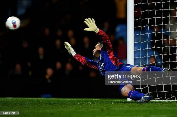 Shay Given of Aston Villa dives unsuccessfully to save the penalty kick of Martin Petrov of Bolton Wanderers during the Barclays Premier League match...