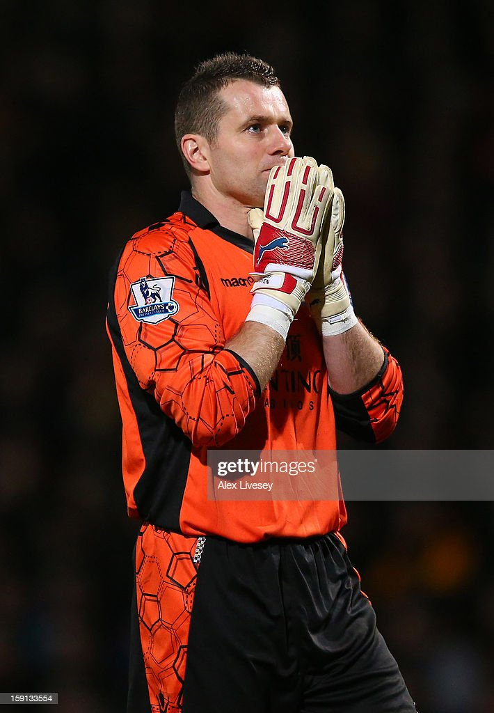 Shay Given of Aston Villa looks dejected during the Capital One Cup Semi-Final 1st Leg match between Bradford City and Aston Villa at Coral Windows Stadium, Valley Parade on January 8, 2013 in Bradford, England.
