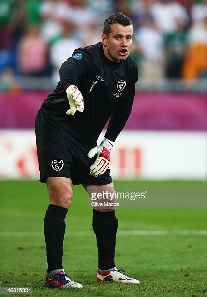 Shay Given of Republic of Ireland directs his defence during the UEFA EURO 2012 group C match between Italy and Ireland at The Municipal Stadium on...