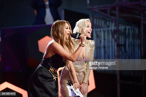 Shay Mitchell and Liz Trinnear present at the 2016 iHeartRADIO MuchMusic Video Awards at MuchMusic HQ on June 19 2016 in Toronto Canada