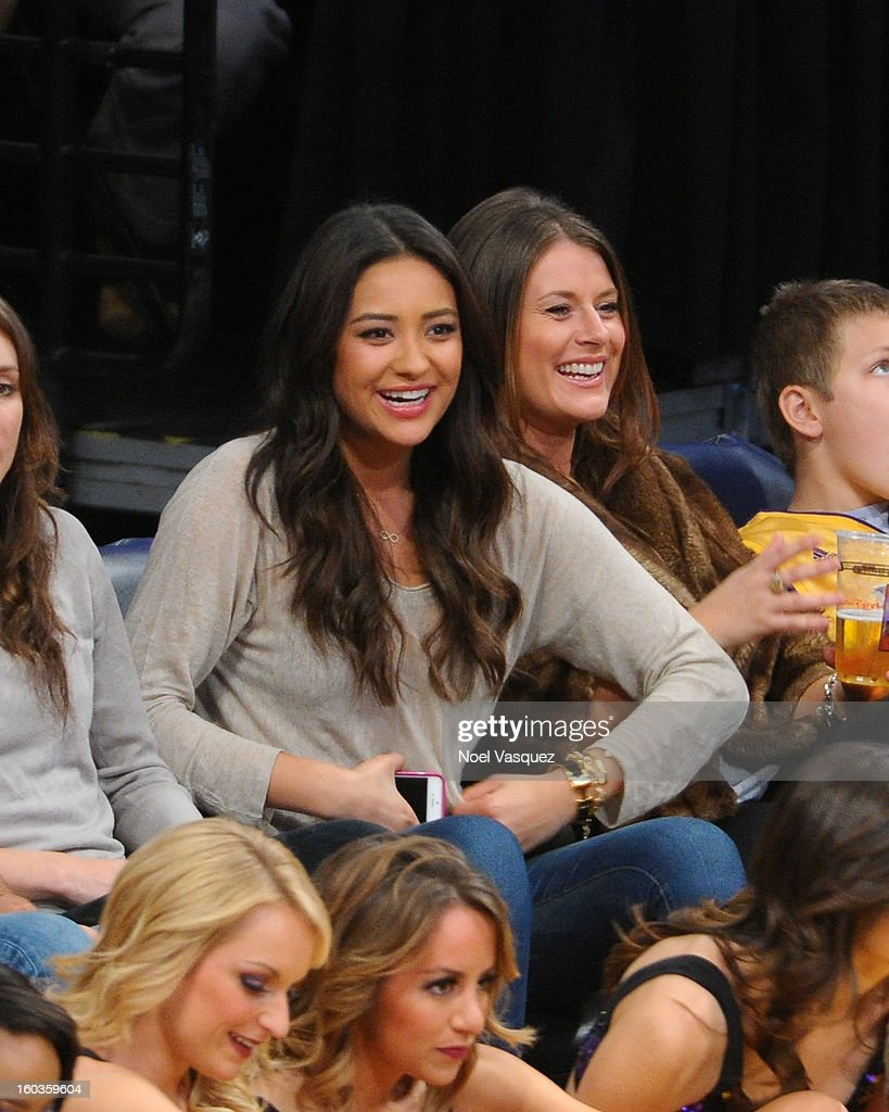 Shay Mitchell (L) and Michaela Blaney attend a basketball game between the New Orleans Hornets and the Los Angeles Lakers at Staples Center on January 29, 2013 in Los Angeles, California.