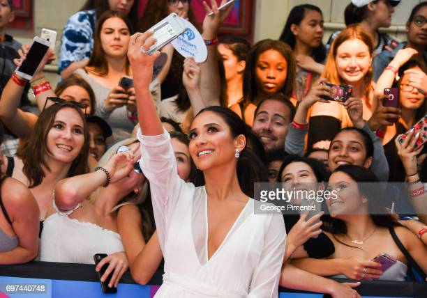 Shay Mitchell poses with fans at the 2017 iHeartRADIO MuchMusic Video Awards at MuchMusic HQ on June 18 2017 in Toronto Canada