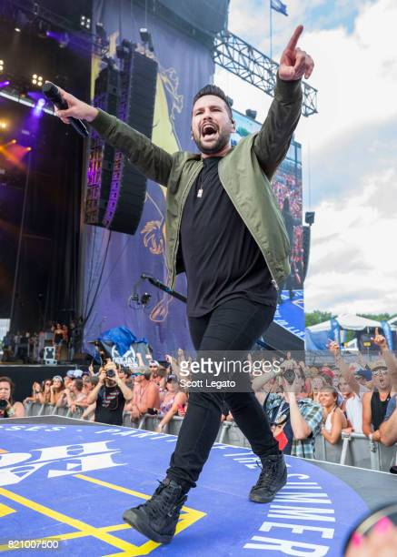 Shay Mooney of Dan Shay performs during day 2 of Faster Horses Festival at Michigan International Speedway on July 22 2017 in Brooklyn Michigan