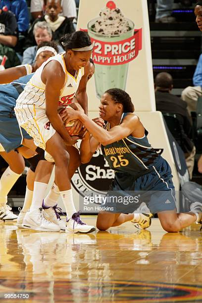 Shay Murphy of the Indiana Fever battles Monique Currie of the Washington Mystics at Conseco Fieldhouse on May 15 2010 in Indianapolis Indiana NOTE...