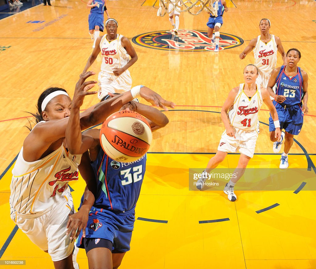 Shay Murphy #14 of the Indiana Fever blocks the shot of Kalana Greene #32 of the New York Liberty at Conseco Fieldhouse on June 5, 2010 in Indianapolis, Indiana.