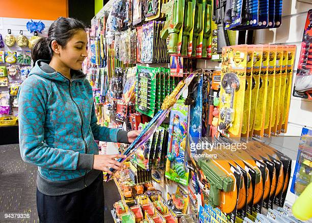 Shayana Patel looks at toys displayed at a Bargain City at North City Shopping Centre in Porirua north of Wellington New Zealand on Saturday Dec 12...