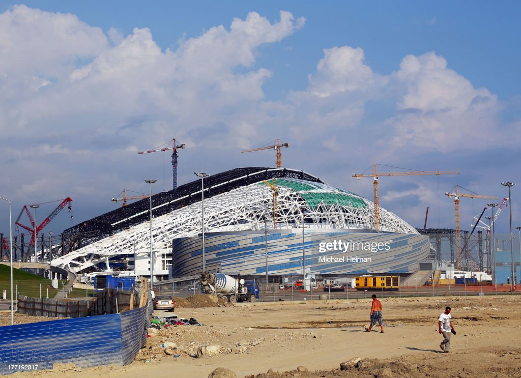 Shayba Arena (front) and Fisht Olympic Stadium (behind) are seen as construction continues on August 21, 2013 in Sochi, Russia.