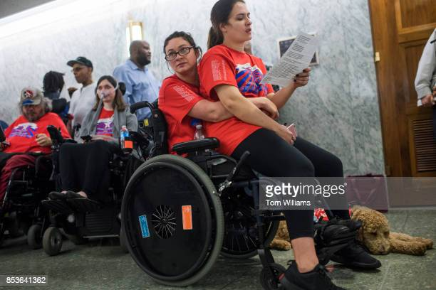 Shaylin Sluzalis right of Williamsport Pa and her sister Brittani who has cerebral palsy wait in line for a Senate Finance Committee hearing in...