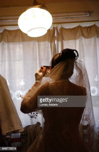 Shayma Hamid retouches her makeup in her bedroom on her wedding day February 20 in Baghdad Iraq With the start of Muharram a muslim holiday which...