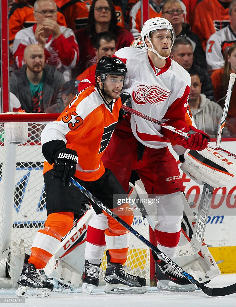 Shayne Gostisbehere #53 of the Philadelphia Flyers battles for position with Anthony Mantha #39 of the Detroit Red Wings on March 15, 2016 at the Wells Fargo Center in Philadelphia, Pennsylvania. The Flyers went on to defeat the Red Wings 4-3.