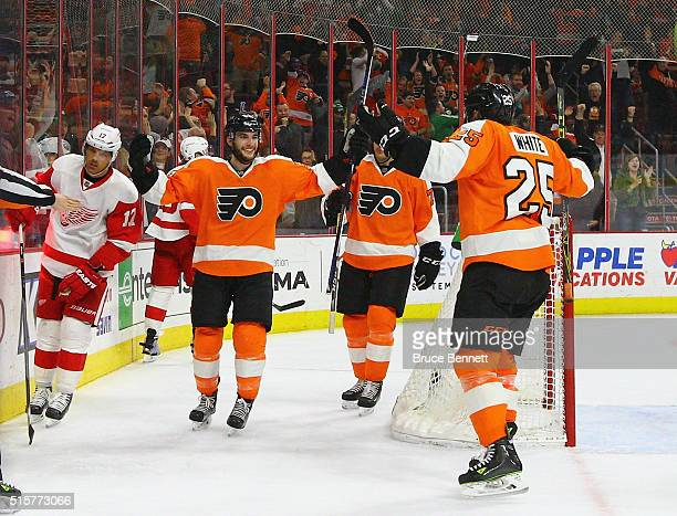 Shayne Gostisbehere of the Philadelphia Flyers celebrates his goal at 1854 of the third period against Petr Mrazek of the Detroit Red Wings and is...