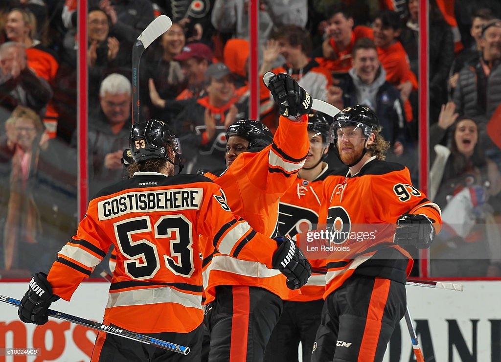 Shayne Gostisbehere #53 of the Philadelphia Flyers celebrates his third period power-play goal against the New Jersey Devils with teammates <a gi-track='captionPersonalityLinkClicked' href=/galleries/search?phrase=Wayne+Simmonds&family=editorial&specificpeople=4212617 ng-click='$event.stopPropagation()'>Wayne Simmonds</a> #17, <a gi-track='captionPersonalityLinkClicked' href=/galleries/search?phrase=Brayden+Schenn&family=editorial&specificpeople=4782304 ng-click='$event.stopPropagation()'>Brayden Schenn</a> #10, and <a gi-track='captionPersonalityLinkClicked' href=/galleries/search?phrase=Jakub+Voracek&family=editorial&specificpeople=4111797 ng-click='$event.stopPropagation()'>Jakub Voracek</a> #93 on February 13, 2016 at the Wells Fargo Center in Philadelphia, Pennsylvania. Gostisbehere's goal gives him an 11-game point streak, which is the longest streak ever by a rookie defenseman in the NHL.
