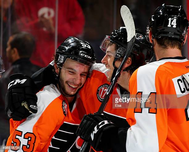 Shayne Gostisbehere of the Philadelphia Flyers is congratulated by Taylor Leier after Gostisbehere scored the game winner in overtime against the...