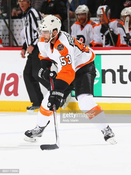 Shayne Gostisbehere of the Philadelphia Flyers plays the puck against the New Jersey Devils during the game at Prudential Center on March 16 2017 in...