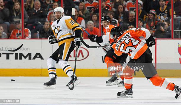 Shayne Gostisbehere of the Philadelphia Flyers shoots the puck against Eric Fehr of the Pittsburgh Penguins on October 29 2016 at the Wells Fargo...
