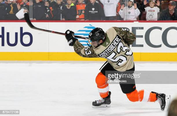 Shayne Gostisbehere of the Philadelphia Flyers wearing a camouflage jersey in honor of Military Appreciation night warms up against the Minnesota...