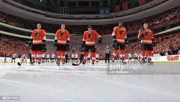 Shayne Gostisbehere Robert Hagg Jordan Weal Wayne Simmonds and Valtteri Filppula of the Philadelphia Flyers stand on the blue line during the...