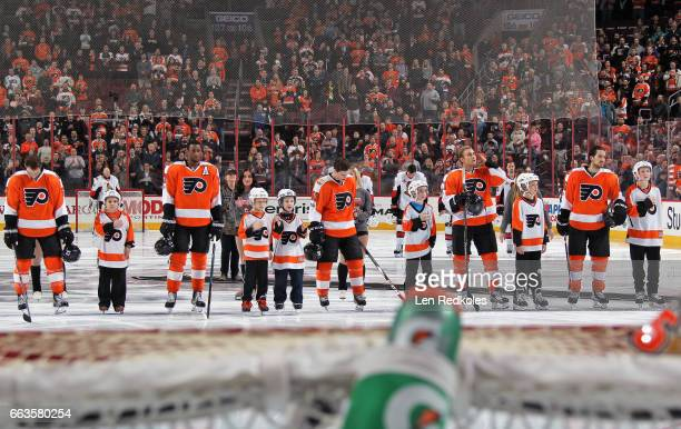 Shayne Gostisbehere Wayne Simmonds Jordan Weal Valtteri Filppula and Michael Del Zotto of the Philadelphia Flyers stand on the blue line during the...