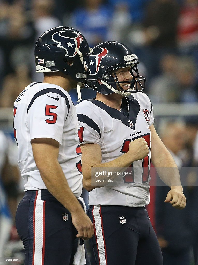 Shayne Graham #17 of the Houston Texans celebrates kicking a 32-yard game-winning field goal in overtime to defeate the Detroit Lions with teammate Donnie Jones #5 at Ford Field on November 22, 2012 in Detroit, Michigan. The Texans defeated the Lions 34-31.