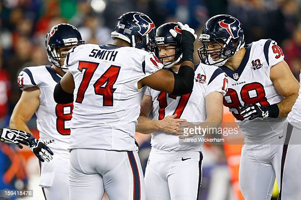Shayne Graham of the Houston Texans celebrates with Connor Barwin and Wade Smith of the Houston Texans after kicking a 55 yard field goal at the end...