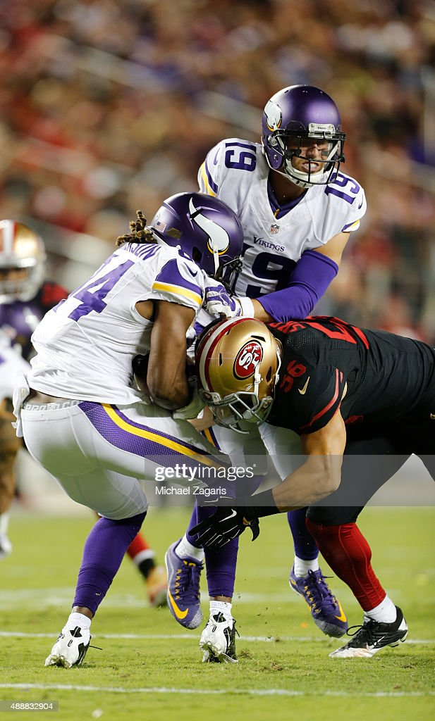 Shayne Skov #56 of the San Francisco 49ers tackles Adrian Peterson #28 of the Minnesota Vikings during the game at Levi Stadium on September 14, 2015 in Santa Clara, California. The 49ers defeated the Vikings 20-3.
