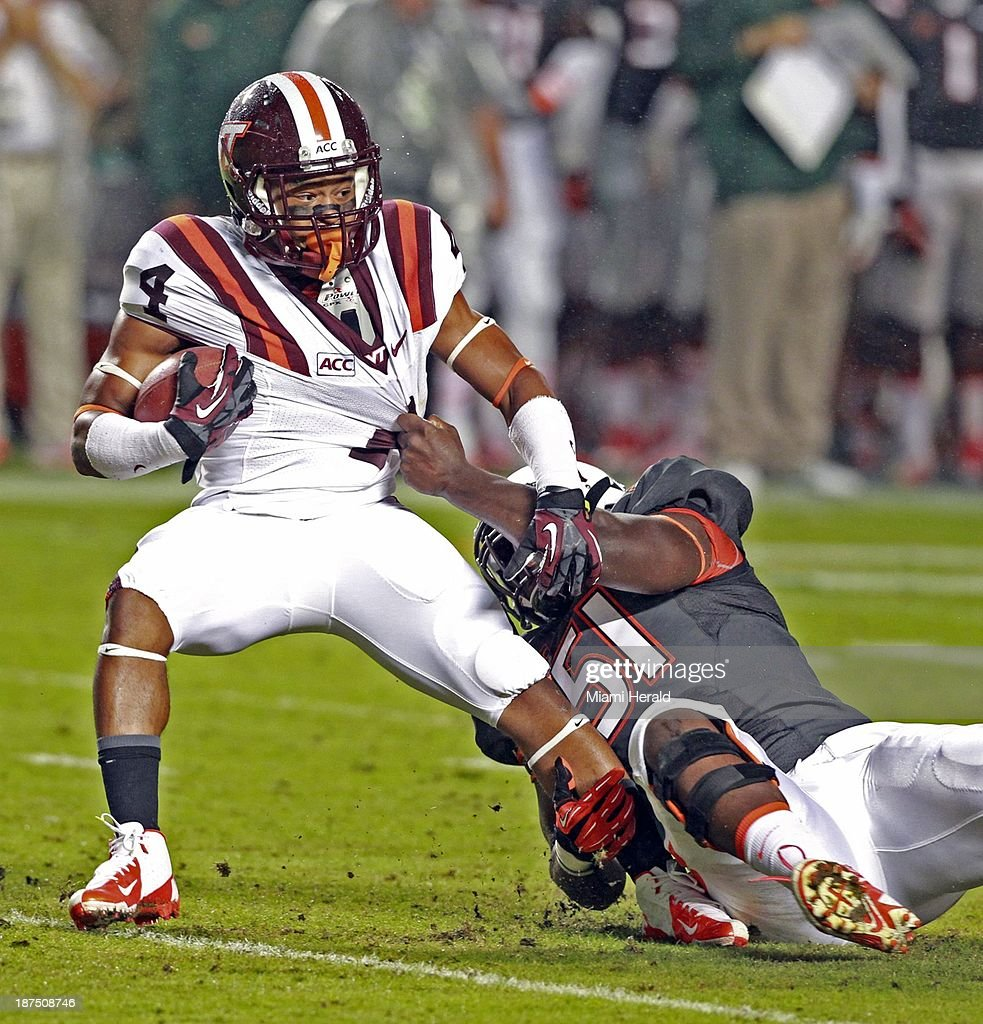 Shayon Green of Miami pulls down J.C. Coleman of Virginia Tech in the first quarter at Sun Life Stadium in Miami Gardens, Fla., on Saturday, Nov. 9, 2013.