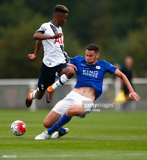 Shayon Harrison of Spurs is tackled by Elliott Moore of Leicester City during the Barclays U21 Premier League match between Tottenham Hotspur U21 and...