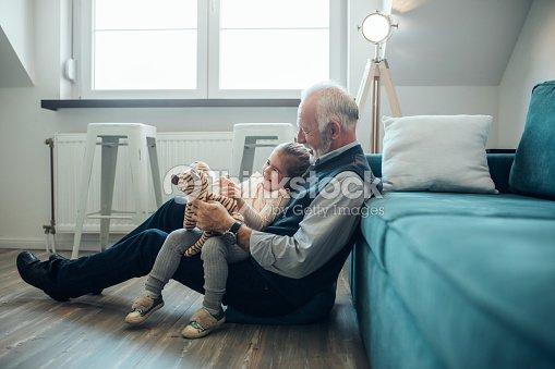 She enjoys grandpa's jokes : Foto de stock