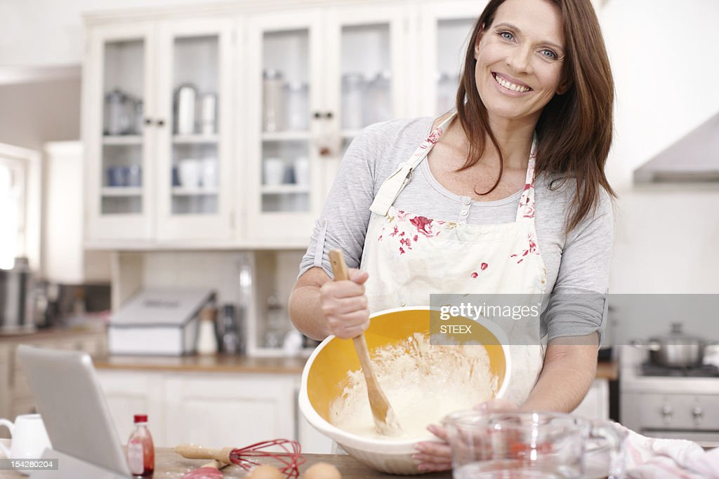 She has fun with baking : Stock Photo