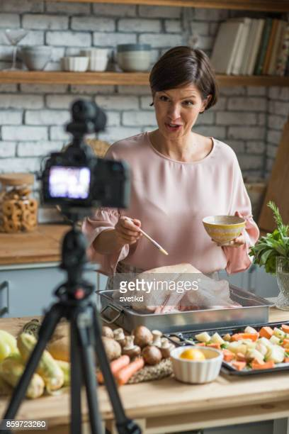 She is enjoying at cooking and filming