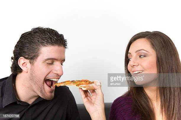 she is feeding him with pizza
