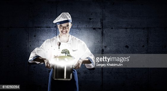She is magician as cook . Mixed media : Stock Photo