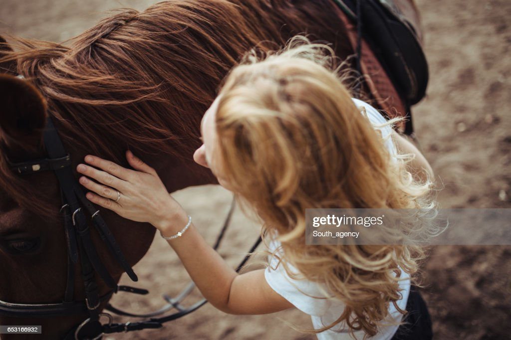 She loves horses : Bildbanksbilder